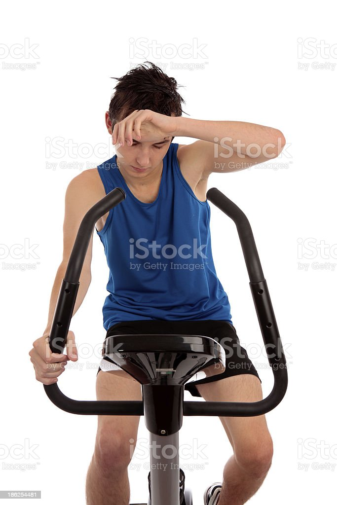 Exhausted after workout on exercise bike royalty-free stock photo