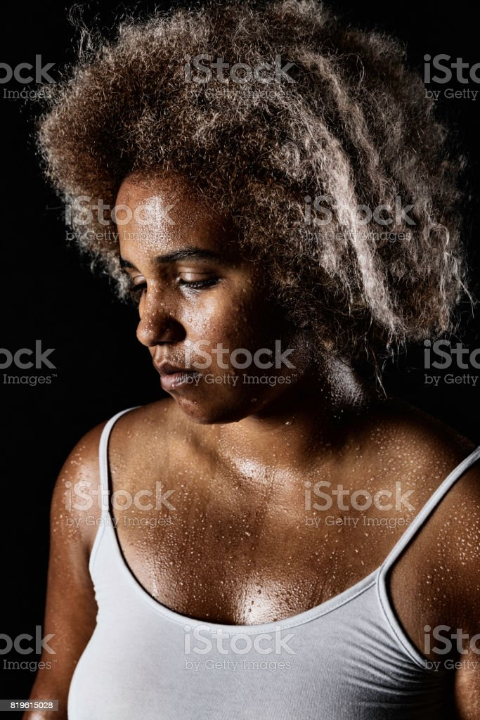 Exhausted and sweaty mixed-race woman stock photo