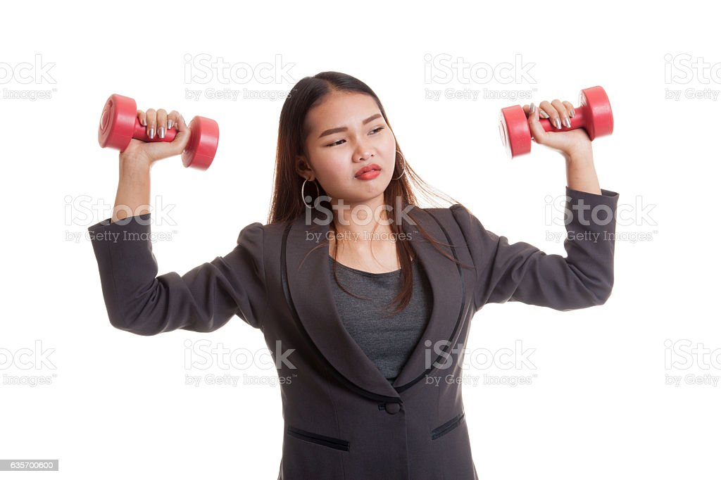 Exhausted Asian business woman with dumbbells. royalty-free stock photo