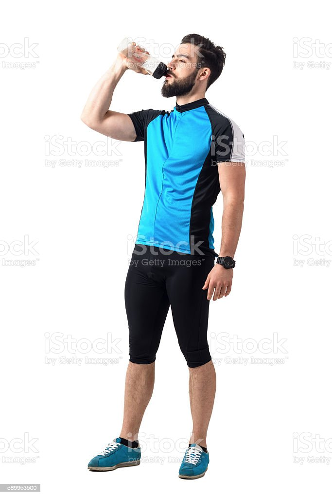 Exhausted Athlete In Bicycling Sportswear Drinking Water