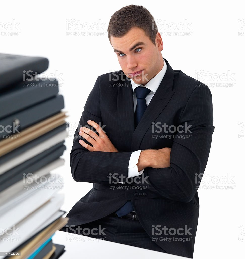 Exhausted business man with a stack of files royalty-free stock photo