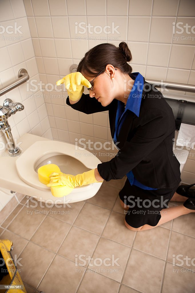 Exhausted Business Woman Cleaning the Restroom Toilet royalty-free stock photo