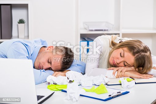 istock Exhausted businessman and businesswoman 628320340