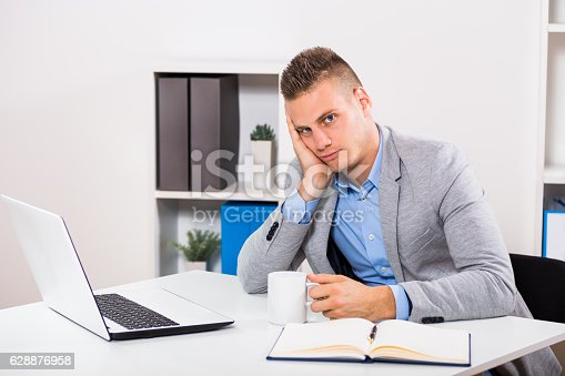 istock Exhausted businessman  drinking coffee 628876958