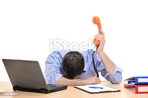 istock Exhausted businessman holding a telephone tube 153765612
