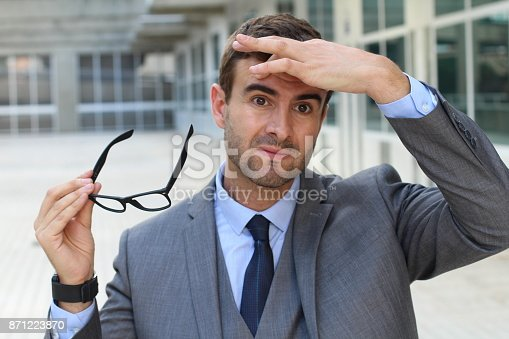 626964348istockphoto Exhausted businessman in office space 871223870