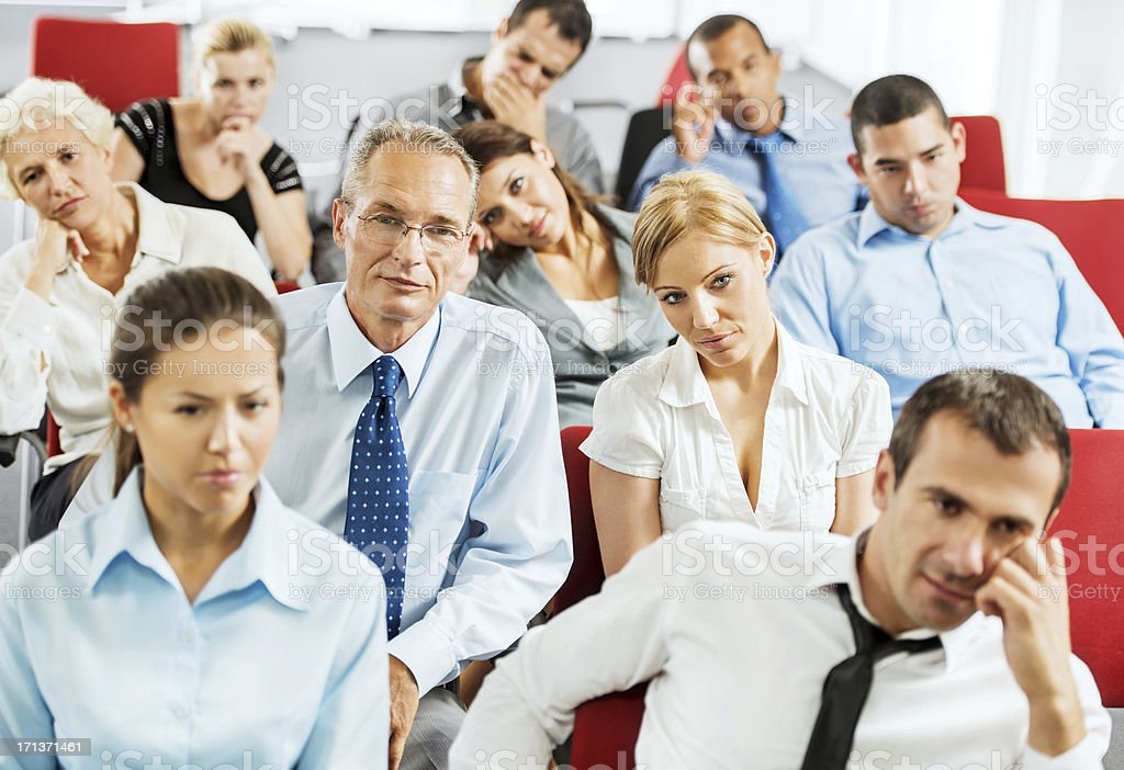 Exhausted businesspeople on a seminar stock photo