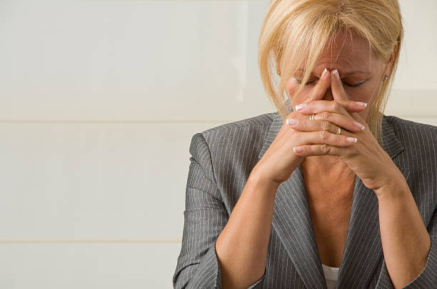 Exhausted businesswoman stock photo