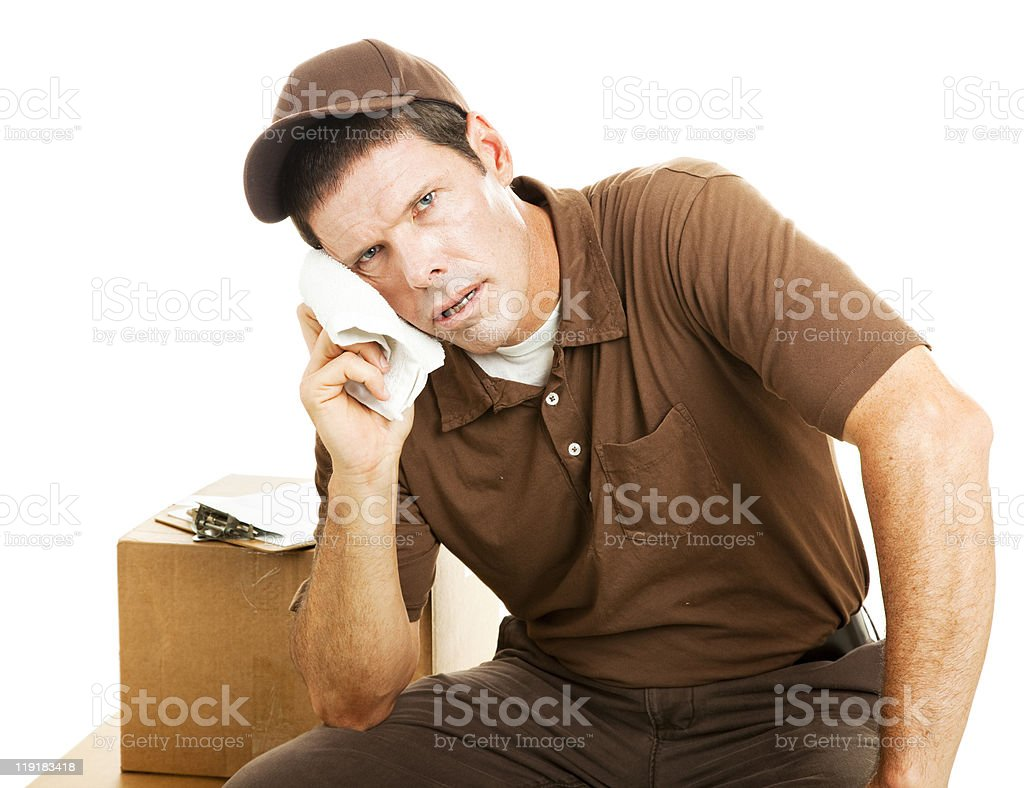 Exhausted Delivery Guy royalty-free stock photo