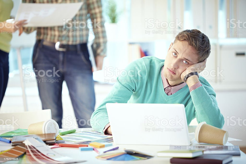 Exhausted designer royalty-free stock photo