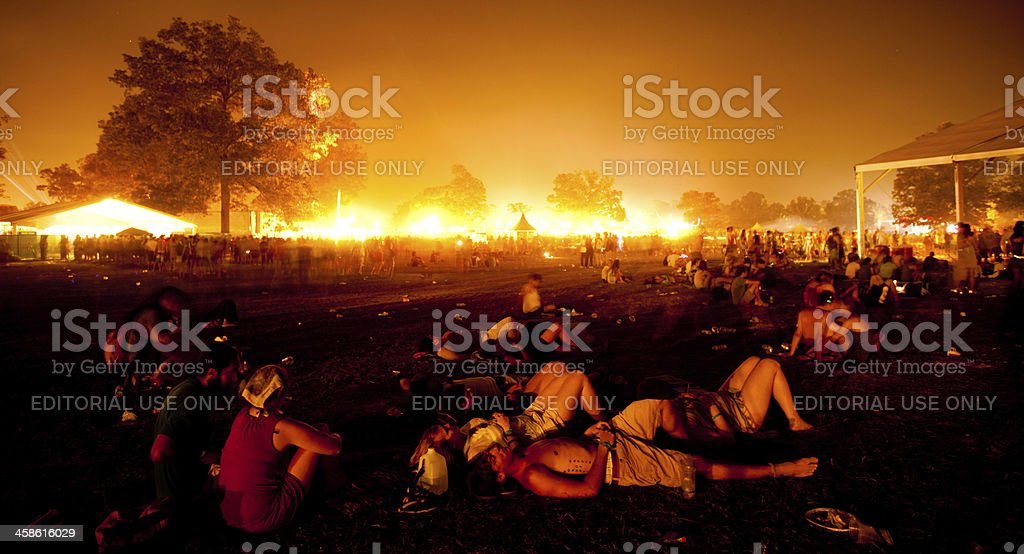 Exhausted fans at a music festival stock photo