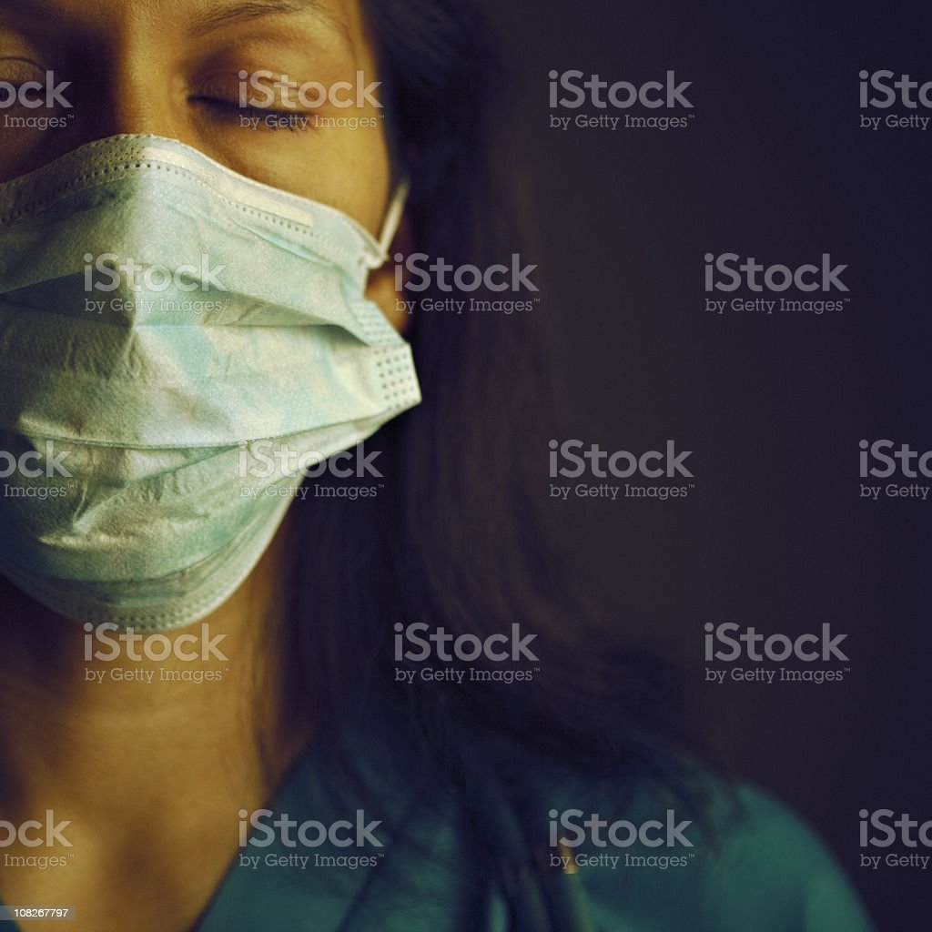 exhausted female doctor royalty-free stock photo