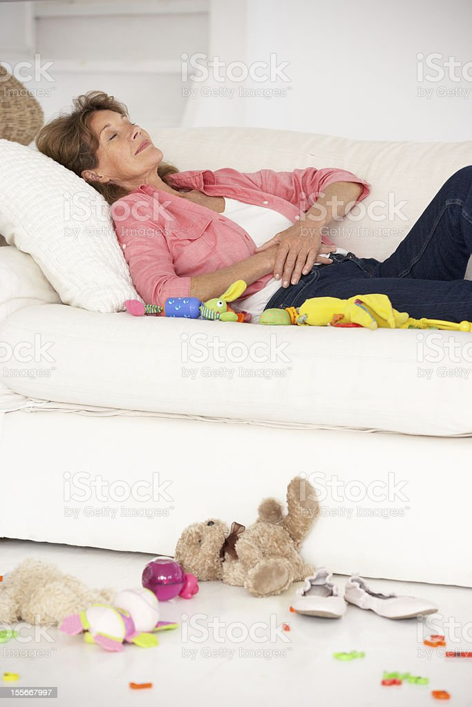 Exhausted grandmother enjoying a rest royalty-free stock photo