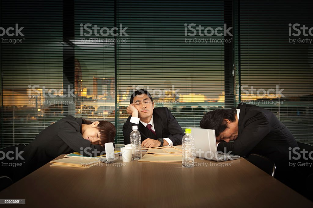 Exhausted Japanese Business Office Workers in Meeting Horizontal stock photo