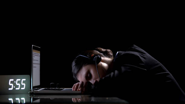 exhausted lady office worker sleeping on laptop, suffering extensive workload - shifts call centre foto e immagini stock