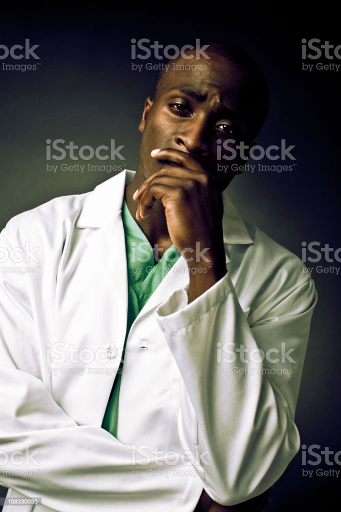 exhausted male doctor royalty-free stock photo