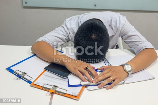 istock Exhausted man feeling stucked with report he dealing with 520876518