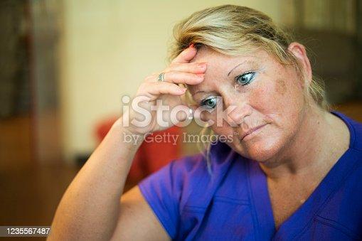 istock Exhausted nurse 1235567487