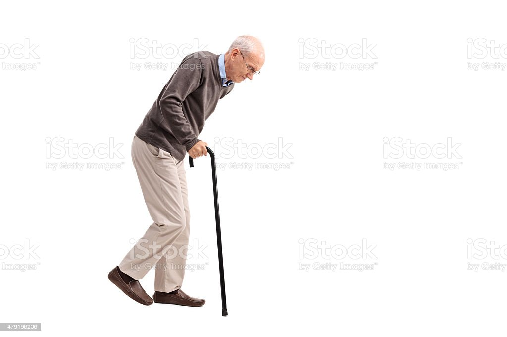 Exhausted old man walking with a cane stock photo