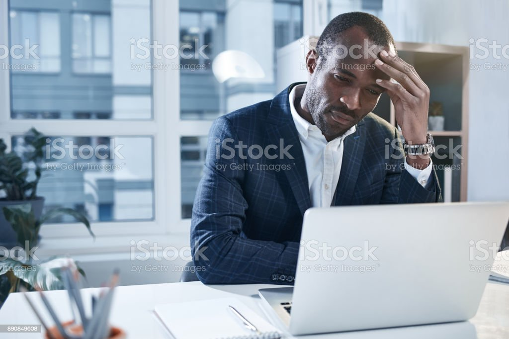 Exhausted pensive employee is using smart gadget stock photo