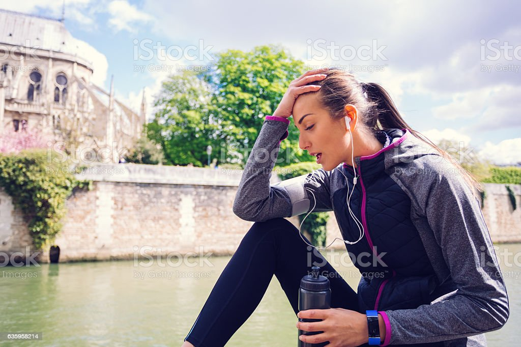 Exhausted sportswoman stock photo