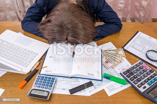 Exhausted woman getting ready for tax day