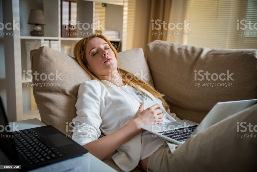 Exhausted woman in office royalty-free stock photo