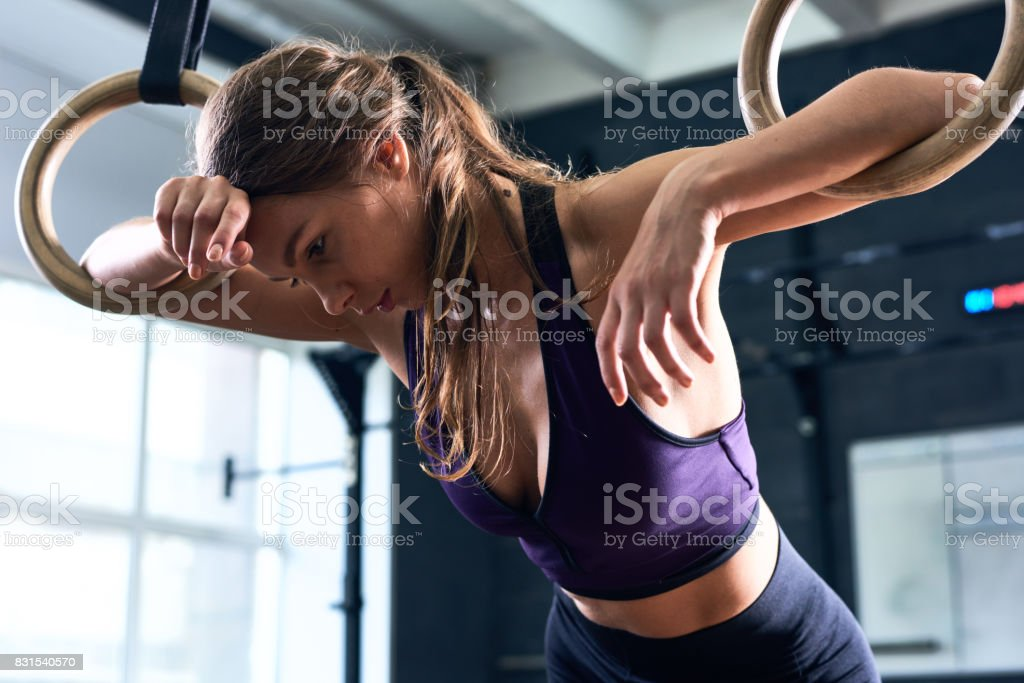 Exhausted Woman Training on Gymnastic Rings - Royalty-free Adult Stock Photo