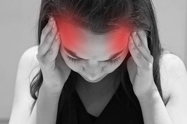 exhausted woman with headache, migraine, stress, hangover stock photo