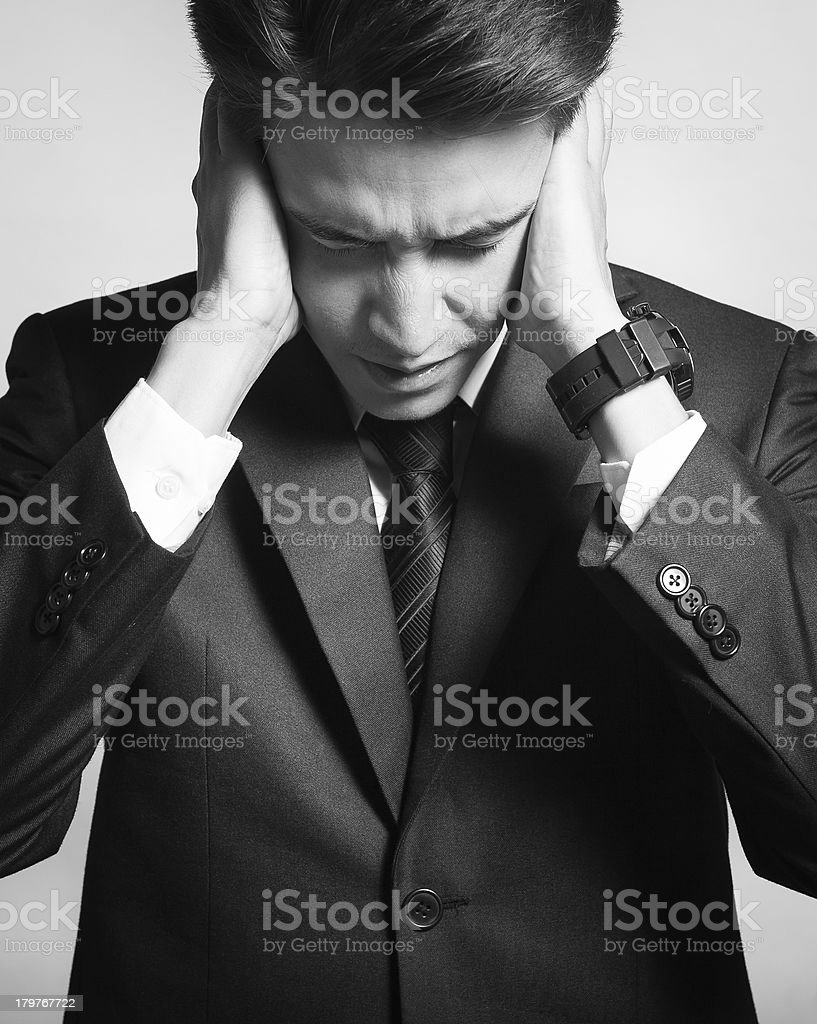 Exhausted young businessman royalty-free stock photo