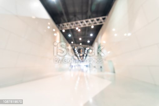 1047189958 istock photo Exhibition event convention hall business blur background of tech expo, trade fair, passenger terminal or museum gallery lobby with blurry interior large corridor hallway white room empty space 1087819570