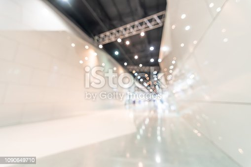 1047189958 istock photo Exhibition event convention hall business blur background of tech expo, trade fair, passenger terminal or museum gallery lobby with blurry interior large corridor hallway white room empty space 1090649710
