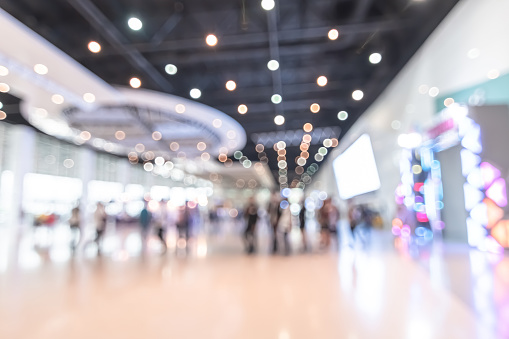 istock Exhibition event hall blur background of trade show business, world or international expo showcase, tech fair, with blurry exhibitor tradeshow booth displaying product with people crowd 1133692578