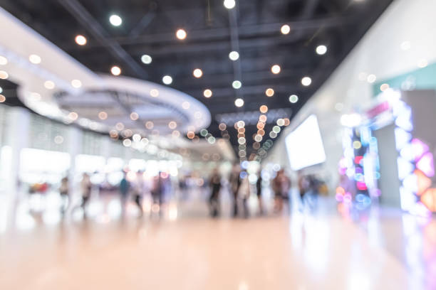 Exhibition event hall blur background of trade show business, world or international expo showcase, tech fair, with blurry exhibitor tradeshow booth displaying product with people crowd Exhibition event hall blur background of trade show business, world or international expo showcase, tech fair, with blurry exhibitor tradeshow booth displaying product with people crowd event stock pictures, royalty-free photos & images