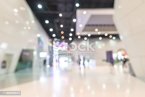 1047189958 istock photo Exhibition event hall blur background of trade show business, world or international expo showcase, tech fair, with blurry exhibitor tradeshow booth displaying product with people crowd 1136699323