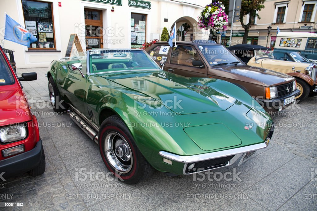 Exhibition of old cars. Interior of an old car. Old design in cars. Beautiful green old Corvette Convertible, side view. Oswiecim city center. – zdjęcie