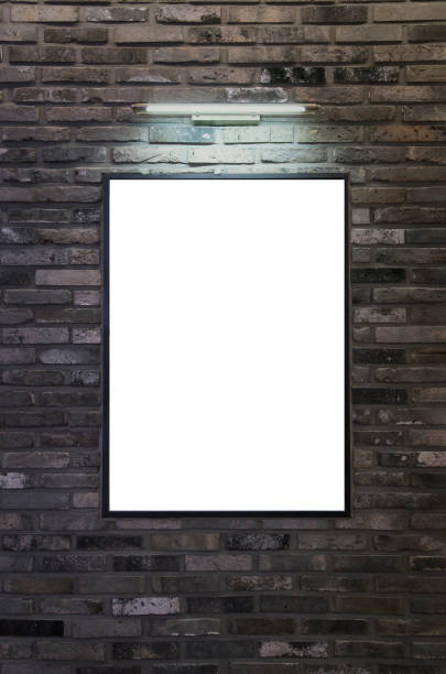 Exhibition or advertising poster frame design template. Brick wall with picture frame and lights. stock photo