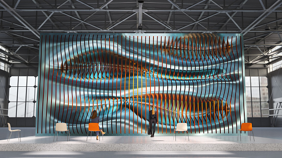 A large sculpture on display in an industrial building. All items in the scene are 3D
