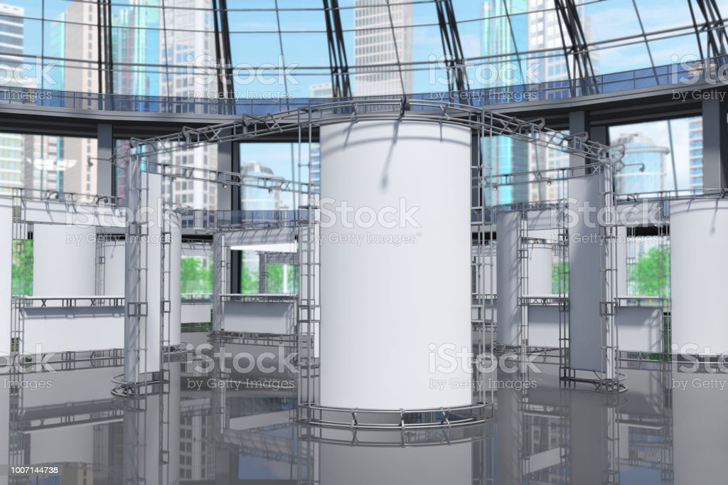 Exhibition stands in a glass pavilion. Skyscrapers outside the windows. stock photo