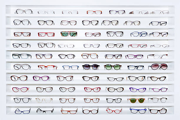 exhibitor of glasses - lens optical instrument stock pictures, royalty-free photos & images
