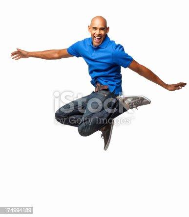 925466128istockphoto Exhilarated Man Jumping - Isolated 174994189