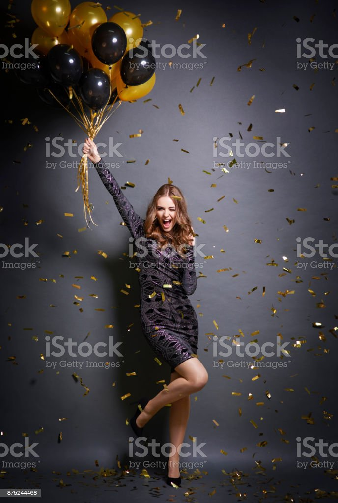 Exhilarated woman dancing at party stock photo