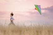Unbridled exhilaration of a young boy flying his kite.