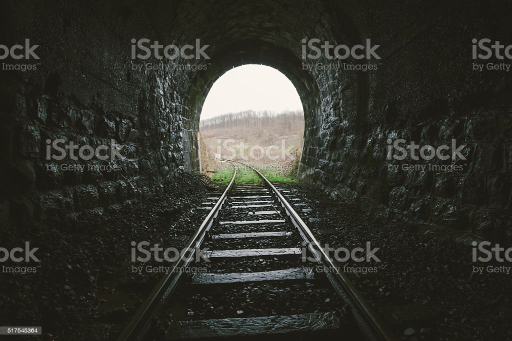 Exit from an old railroad tunnel stock photo