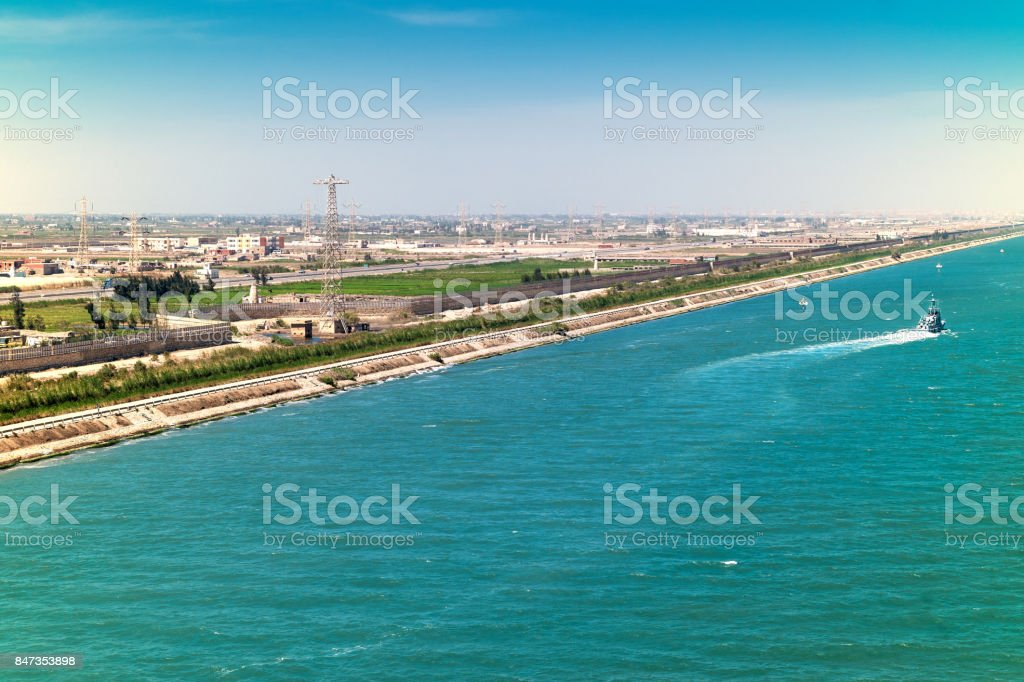 Exit from the Suez Canal into the Mediterranean along the port cities of Port Said and Port Fouad stock photo