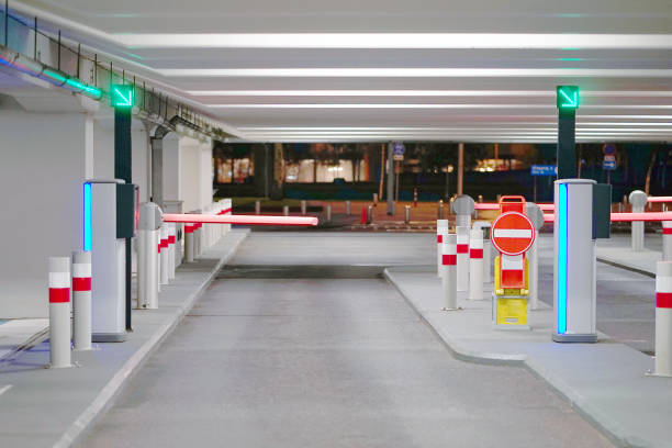 Exit from underground parking Barrier at Entrance and exit of a car Parking garage. barrier in a car park. Exit from underground parking. Underground parking/garage. Interior of parking security equipment stock pictures, royalty-free photos & images