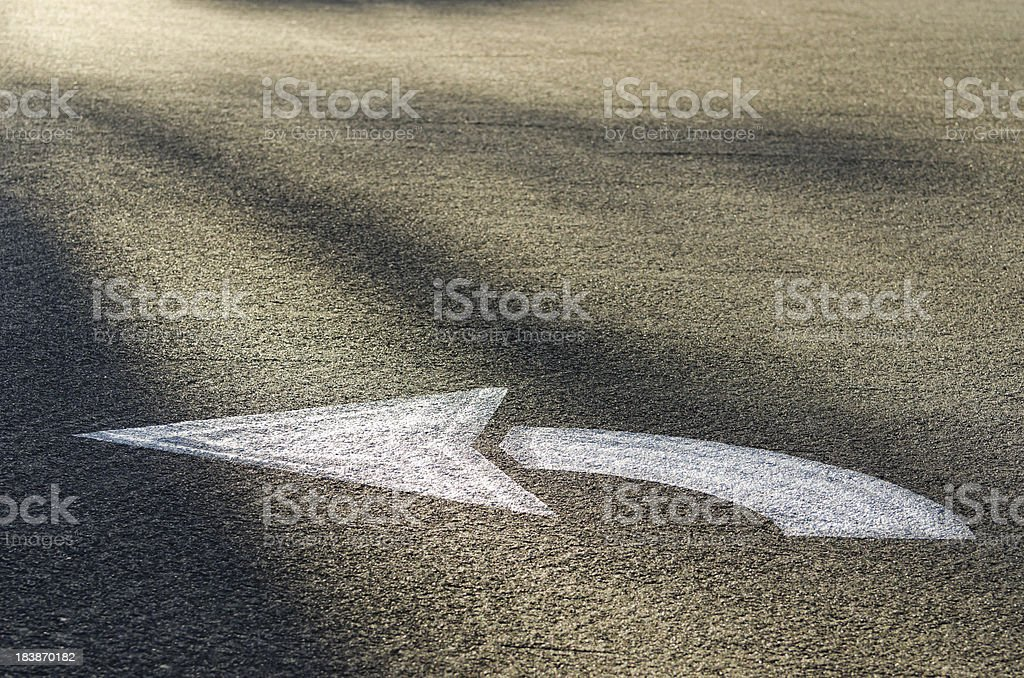 Exit Left Arrow on Highway Pavement royalty-free stock photo