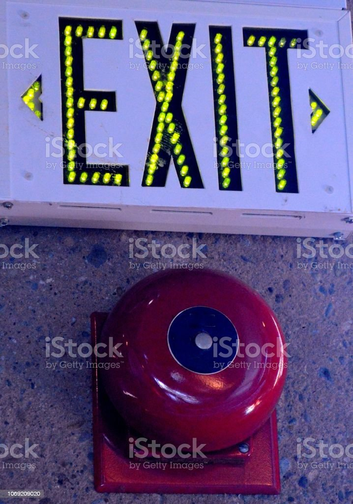 Exit sign and fire alarm stock photo
