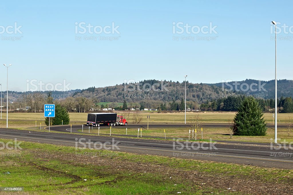 Exit Sign at Rest Area Truck Freeway Blue Sky Trees royalty-free stock photo