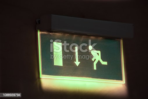 1182906669istockphoto Exit sign glowing at night 1088939794
